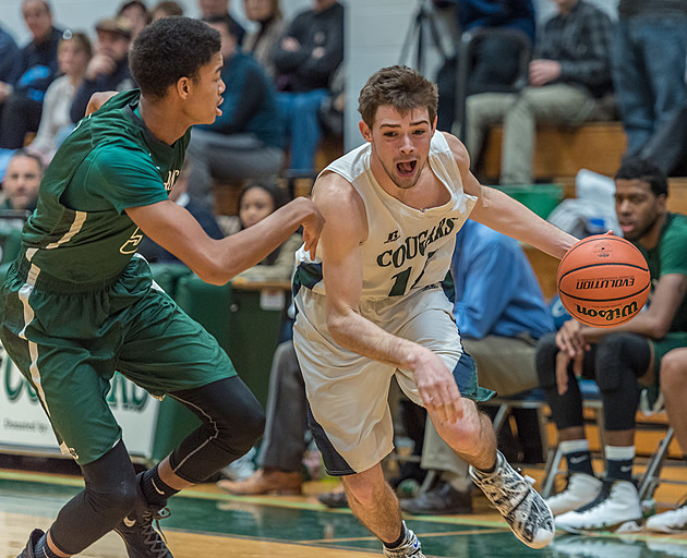Colts Neck's Tom O'Reilly drives against Long Branch's T.J. Fosque. (Photo by Rob Samuels)