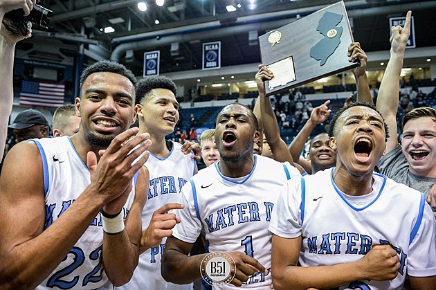 From left: Josh Green, Elijah Barnes, Marvin Pierre and Kenny Jones celebrate while NyQuan McCombs raises the trophy.(Photo by Mark Brown)