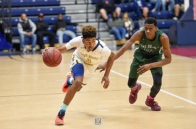 Toms River North's Darrion Carrington drives past Long Branch's Tyree Morris Sunday. (Photo by Mark Brown, B51 Photography)