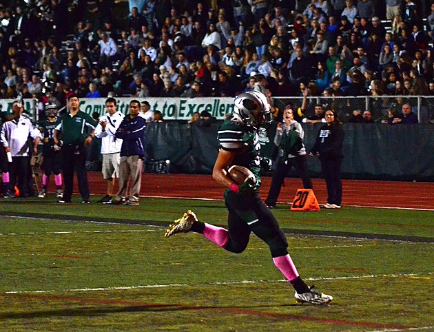 Senior running back Vito Aleo (at right) had a career-high 256 yards rushing and three touchdowns on Senion Night to power Raritan. (Photo by Bruce Willence)