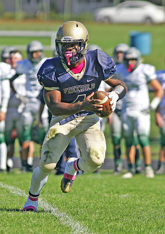Freehold quarterback Ashante Worthy set the Shore Conference single-game record for rushing yards and total touchdowns in a 69-56 playoff win over Pennsauken. (Photo by Bill Normile).