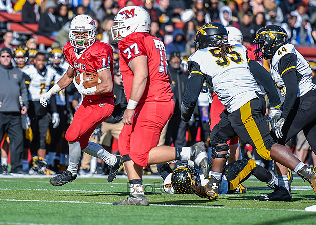Junior running back Naim Mayfield (11) was the lone bright spot for Manalapan in its los to Piscataway with 160 yards rushing and two touchdowns. (Photo by Robert Samuels).