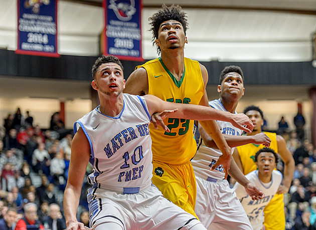 Patrick School's imposing size, led by 6-foot-11 Kentucky recruit Nick Ricchards (in yellow) helped the Celtics control the boards. (Photo by Robert Samuels)