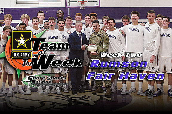 Rumson-Fair Haven basketball coach Chris Champeau and Staff Sgt. Sthan Newago pose with the Bulldogs basketball team. (Photo by Steve Meyer)