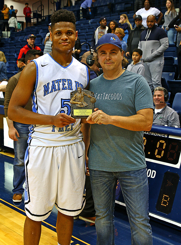 Elijah Mitchell accepts his game MVP award. (Photo by Ray Richardson)