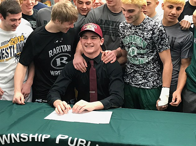 Raritan's Ryan Dickens signs his National Letter of Intent to Lafayette College. (Photo by Robert Badders).