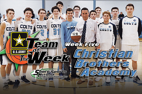 Coach Geoff Billet and CBA accept the Team of the Week game ball. (Photo by Steve Meyer)