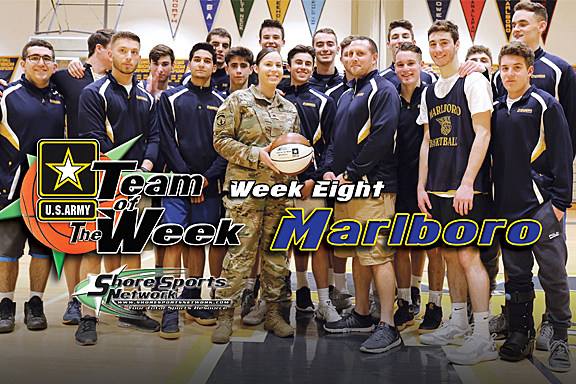 Marlboro coach Mike Nausedas and his team accept the Team of the Week Game Ball from U.S. Army Sgt. Jelissa Torres. (Photo by Steve Meyer)