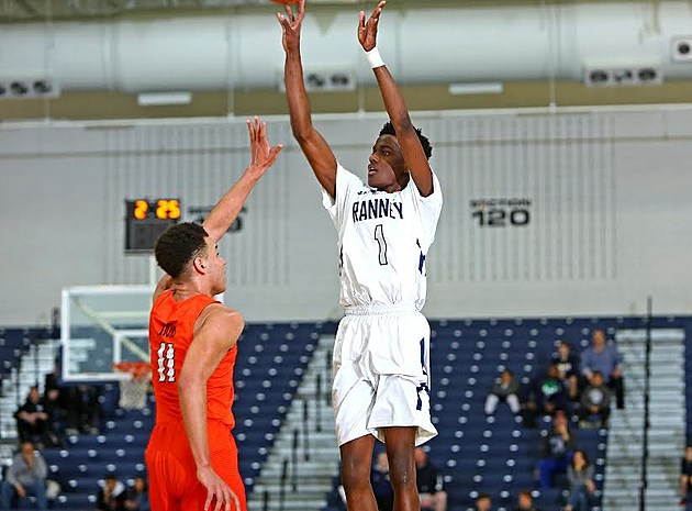 Bryan Antoine raises up for the 3-pointer that put him over the 1,000-point mark as a sophomore. (Photo by Ray Richardson)
