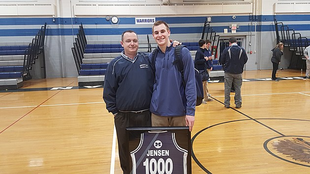 Manasquan senior Devin Jensen celebrated becoming the 10th player to reach 1,000 points in Manasquan history with head coach Andrew Bilodeau. (Photo by Scott Stump)