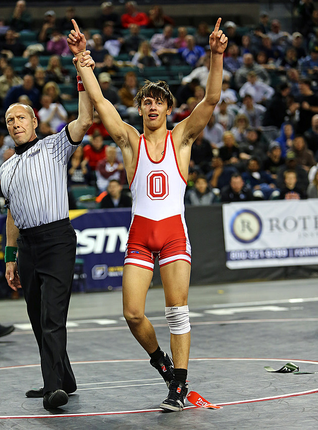 Ocean's Jake Benner has his hand raised after winning the 138-pound NJSIAA state title. (Photo by Ray Richardson).