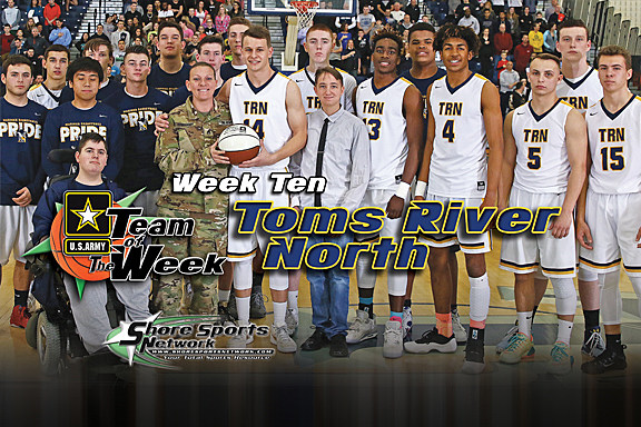 Toms River North senior Mike Nyisztor and his Mariners teammates accept the Team of the Week game ball from Staff Sgt. Nicole McMinamin. (Photo by Steve Meyer)