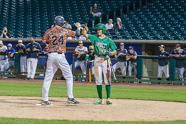 Brick senior John Prato congratulates Middletown North senior Mike Mercier on his solo home run. (Photo by Paula Lopez)