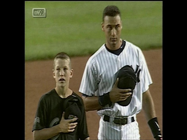 Toms River's Todd Frazier  stands next to New York Yankees shortstop Derek Jeter in 1998 when LLWS champions Toms River East American visited Yankee Stadium.